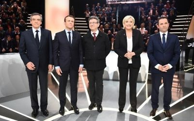 French presidential election candidates, right-wing Les Republicains (LR) party Francois Fillon, En Marche! movement Emmanuel Macron, far-left coalition La France insoumise Jean-Luc Melenchon, far-right Front National (FN) party Marine Le Pen, and left-wing French Socialist (PS) party Benoit Hamon, pose before a debate organised by the French private TV channel TF1 on March 20, 2017 in Aubervilliers, outside Paris.  (AFP/Pool/Eliot Blondet)