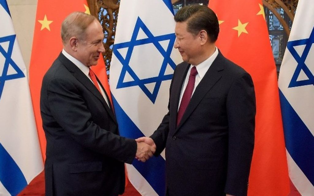 Prime Minister Benjamin Netanyahu and China's President Xi Jinping (R) shake hands ahead of their talks at Diaoyutai State Guesthouse in Beijing on March 21, 2017. (AFP Photo/Pool/Etienne Oliveau)