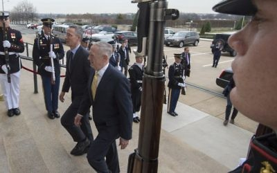 US Secretary of Defense James Mattis (R) hosts an honor cordon to welcome Jens Stoltenberg, Secretary General of the North Atlantic Treaty Organization (NATO) on March 21, 201, at the Pentagon, in Washington, DC. (AFP PHOTO / PAUL J. RICHARDS)