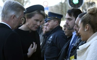 King Philippe of Belgium (L) and Queen Mathilde of Belgium (2ndL) meet victims and relatives during a memorial for the first anniversary of the twin Brussels attacks by Islamic extremists on March 22, 2017. (AFP Photo/Pool/Didier Lebrun)