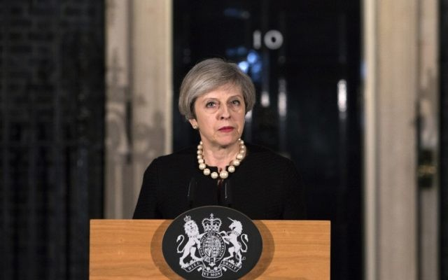 British Prime Minister Theresa May speaks outside 10 Downing Street in central London on March 22, 2017, following the terror incident at the Houses of Parliament. (AFP Photo/Pool/Richard Pohle)