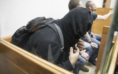 The father of American-Israeli Jewish teenager, accused of making dozens of anti-Semitic bomb threats in the United States and elsewhere, sits in the Israeli Justice court in Rishon Lezion on March 23, 2017. (AFP/JACK GUEZ)