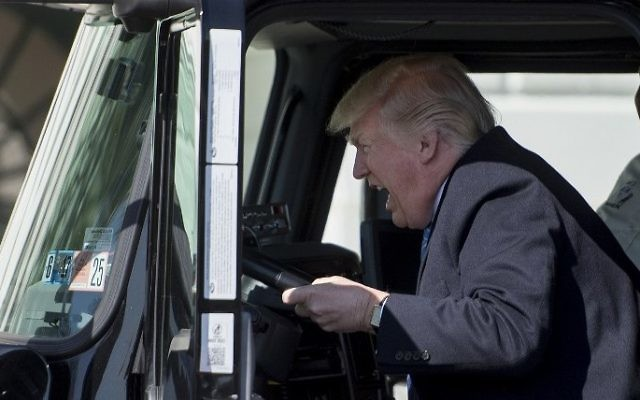 US President Donald Trump sits in the driver's seat of a semitrailer as he welcomes truckers and CEOs to the White House in Washington, DC, to discuss healthcare, March 23, 2017. (AFP/Jim Watson)