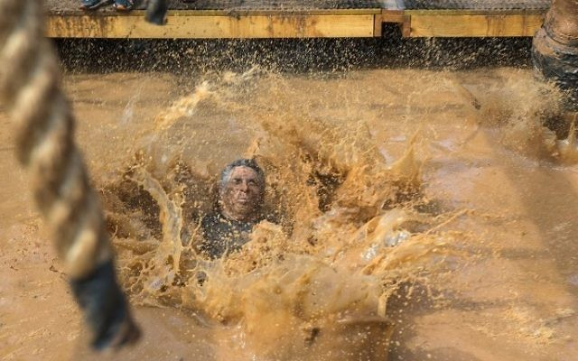 Participants take part in the Mud Day race, a 13km obstacle course, on March 24, 2017 in the Israeli Mediterranean coastal city of Tel Aviv. (Jack Guez/AFP)