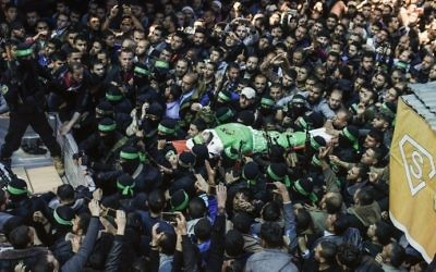The body of Hamas terrorist Mazen Faqha is carried by members of the Ezzedine al-Qassam Brigades, the military wing of Hamas, during his funeral in Gaza city on March 25, 2017. (AFP/Mahmud Hams)