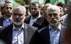 Yahya Sinwar (R) the new leader of Hamas in the Gaza Strip and senior Hamas official Ismail Haniyeh attend the funeral of Hamas official Mazen Faqha in Gaza city on March 25, 2017. (AFP Photo/Mahmud Hams)