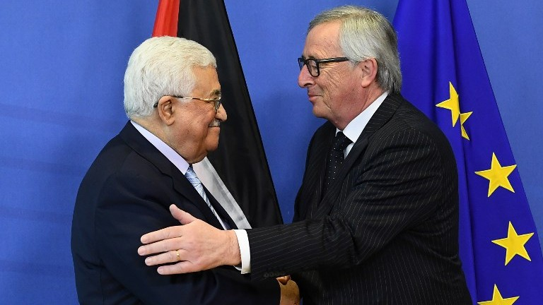 Palestinian Authority President Mahmoud Abbas (L) is welcomed by European Commission President Jean-Claude Juncker at the European Commission in Brussels on March 27, 2017. (AFP Photo/Emmanuel Dunand)