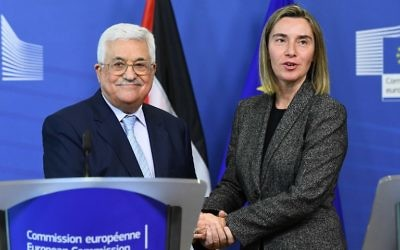 Palestinian Authority President Mahmoud Abbas (L) speaks with EU foreign policy chief Federica Mogherini during a press conference following their meeting at the European Commission in Brussels on March 27, 2017. ( EMMANUEL DUNAND / AFP)
