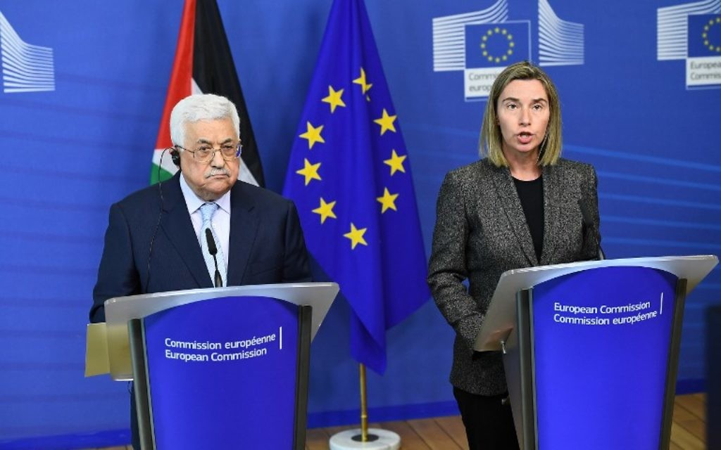 Palestinian Authority President Mahmoud Abbas (L) and EU foreign policy chief Federica Mogherini give a press conference following their meeting at the European Commission in Brussels on March 27, 2017. (AFP PHOTO / EMMANUEL DUNAND)