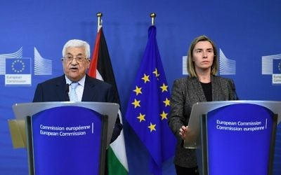 Palestinian Authority President Mahmoud Abbas (L) and EU foreign policy chief Federica Mogherini give a press conference following their meeting at the European Commission in Brussels on March 27, 2017. (AFP Photo/Emmanuel Dunand)