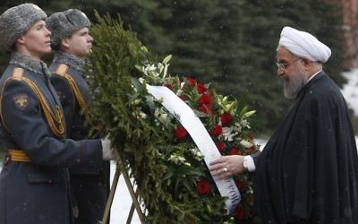 Iranian President Hassan Rouhani takes part in a wreath laying ceremony at the Tomb of the Unknown Soldier by the Kremlin wall in Moscow on March 28, 2017. Maxim Shemetov/AFP)