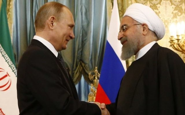 Russian President Vladimir Putin (L) shakes hands with his Iranian counterpart Hassan Rouhani during their meeting at the Kremlin in Moscow on March 28, 2017. (Sergei Karpukhin/AFP)