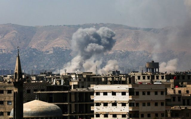 A general view shows moke rising from buildings following an air strike on Jobar, a rebel-held district on the eastern outskirts of the Syrian capital Damascus, March 28, 2017. (AFP/AMER ALMOHIBANY)