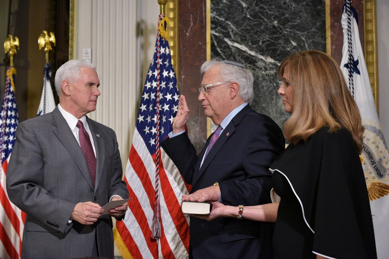 US Vice President Mike Pence (L) administers the swearing-in ceremony for David Friedman (C) as the US ambassador to Israel, as his wife Tammy Sand looks on, in the Indian Treaty Room of the Eisenhower Executive Office Building, next to the White House, on March 29, 2017 in Washington, DC. (AFP/Mandel Ngan)