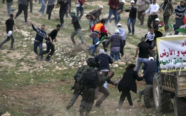 Illustrative: Palestinian demonstrators clash with Israeli security forces following a protest to mark Land Day in the village of Madama, south of Nablus, in the West Bank, March 30, 2017. (AFP/JAAFAR ASHTIYEH)