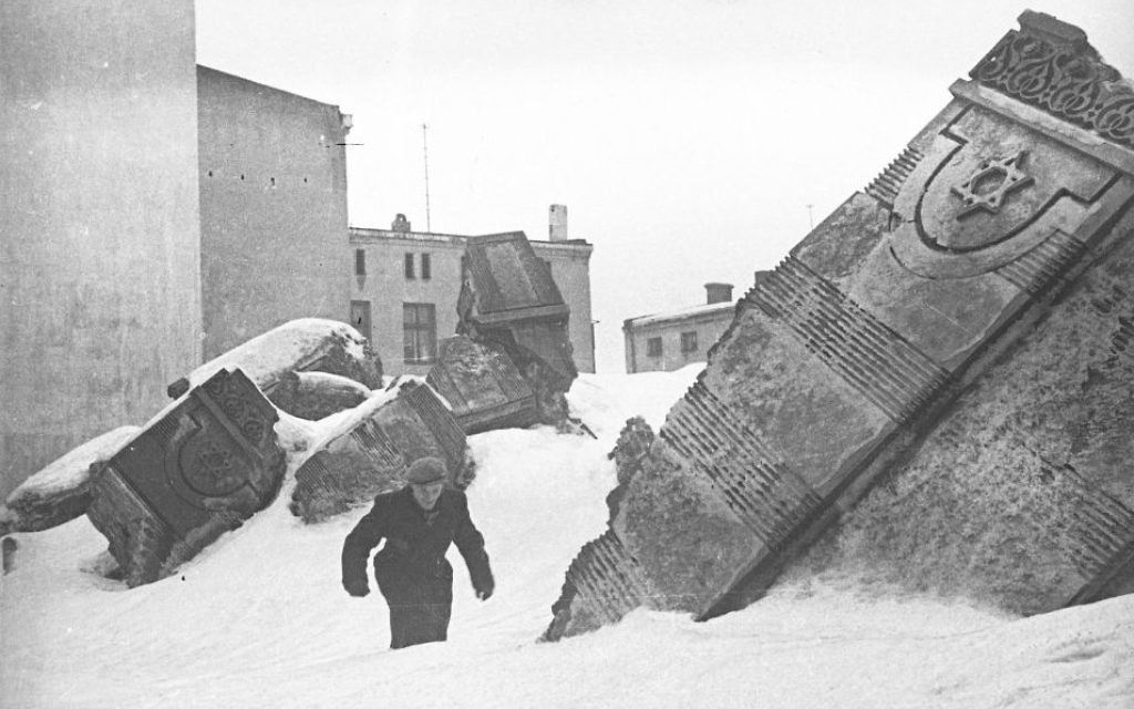 A man walking in the ruins of the synagogue during wintertime. (Henryk Ross/Art Gallery of Ontario, gift from the Archive of Modern Conflict/Courtesy Museum of Fine Arts)