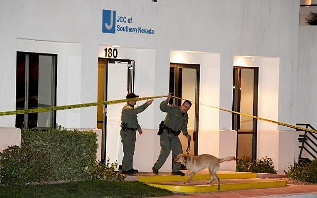 Las Vegas Metropolitan Police Department K-9 officers search the Jewish Community Center of Southern Nevada after an employee received a suspicious phone call that led about 10 people to evacuate the building on February 27, 2017 in Las Vegas, Nevada. (Ethan Miller/Getty Images/AFP)