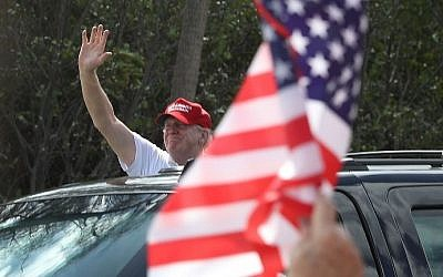 US President Donald Trump waves to supporters near his Mar-a-Lago resort home on March 4, 2017 in West Palm Beach, Florida. (Joe Raedle/Getty Images/AFP)