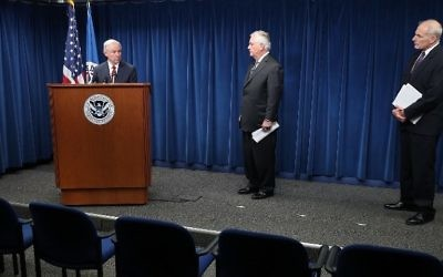 Attorney General Jeff Sessions , left, speaks as Secretary of Homeland Security John Kelly, right, and Secretary of State Rex Tillerson look on, during a news conference about issues related to a reconstituted travel ban at the US Customs and Borders Protection headquarters, on March 6, 2017 in Washington, DC. Mark Wilson/Getty Images/AFP)