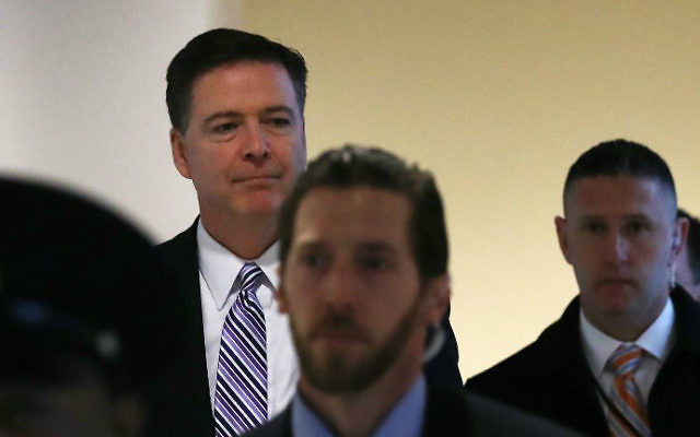 FBI Director James Comey (L) leaves a closed door meeting with senators at the US Capitol, March 15, 2017, in Washington, DC. (Mark Wilson/Getty Images/AFP)