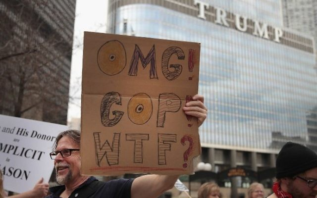 Demonstrators gather near Trump Tower to celebrate the defeat of President Donald Trump's revision of the Affordable Care Act (ACA) on March 24, 2017 in Chicago, Illinois. (Scott Olson/Getty Images/AFP)