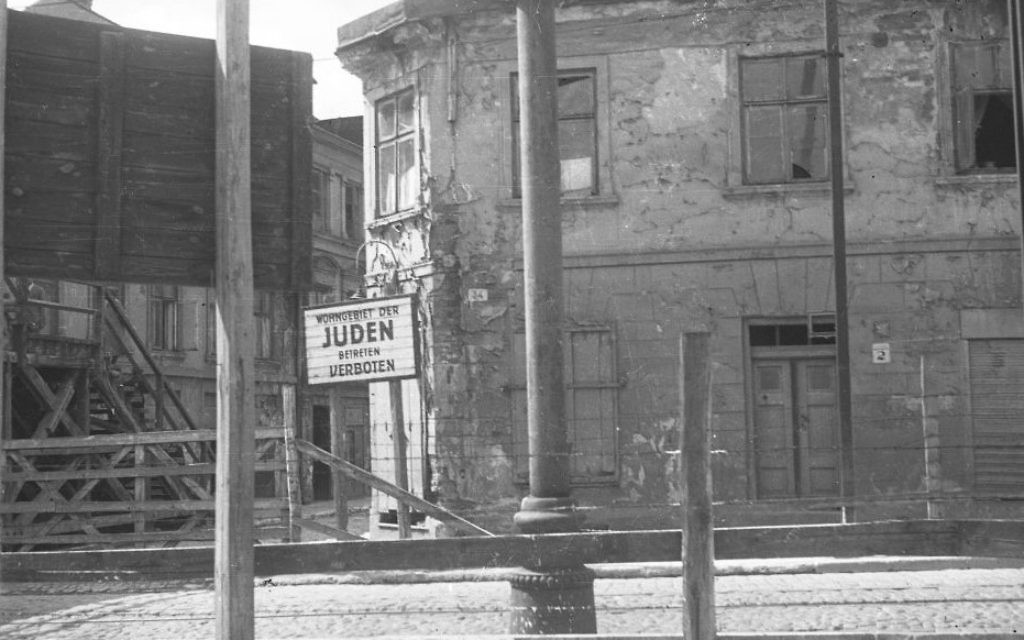The Lodz ghetto residential area sign reading, 'Jews. Entry Forbidden.' (Henryk Ross/Art Gallery of Ontario, gift from the Archive of Modern Conflict/Courtesy Museum of Fine Arts)
