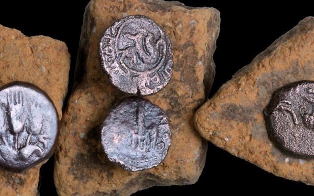 Ancient coins that were discovered in an excavation of a Roman road near Beit Shemesh in February 2017. (Clara Amit, courtesy of the Israel Antiquities Authority)