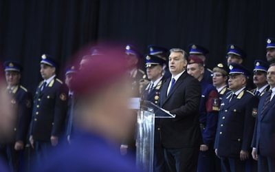 "Hungarian Prime Minister Viktor Orban,delivers a speech during a swearing-in-ceremony for a new group of border guards known locally as ""border hunters,"" in Budapest, Hungary, Tuesday, March 7, 2017. (Szilard Koszticsak/MTI via AP)"