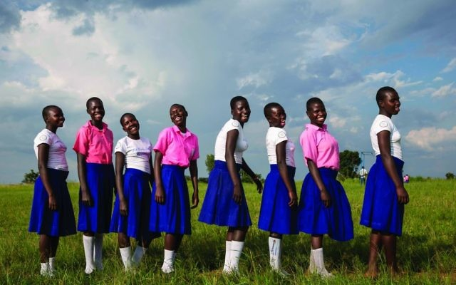 AJWS's support enables these Ugandan girls to stay in school and learn about their health and rights. (Jonathan Torgovnik)