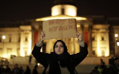 A woman holds up a sign at a vigil for the victims of Wednesday's attack, at Trafalgar Square in London, Thursday, March 23, 2017.  (AP Photo/Matt Dunham)
