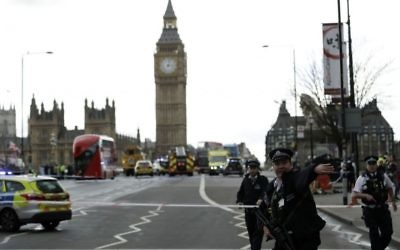 Police secure the area on the south side of Westminster Bridge close to the Houses of Parliament in London, Wednesday, March 22, 2017, during a terror attack in which 3 people were killed by an assailant, including a policeman. (AP Photo/Matt Dunham)