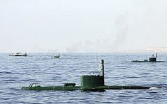 Iranian submarines and warships participate in a navy drill in the Sea of Oman in December, 2011 (AP Photo/Young Journalists Club, Mohammad Ali Marizad)
