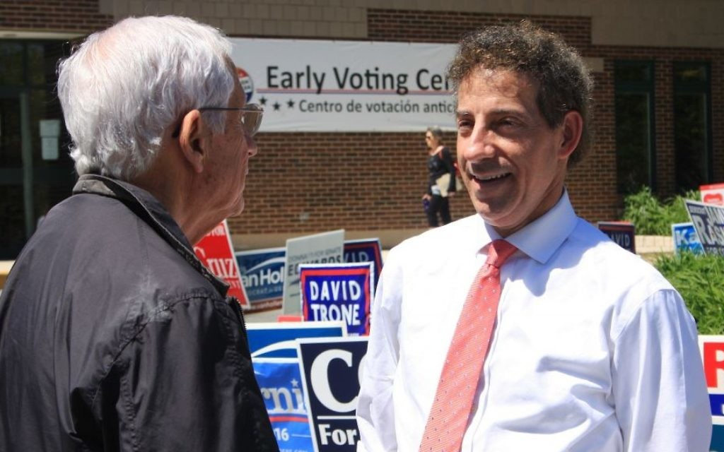 Then State Sen. Jamie Raskin talks to a supporter who voted early for him on Wednesday, April 20, 2016 before he successfully won his seat to represent Maryland's 8th congressional district in the House of Representatives. (AP Photo/Brian Witte)