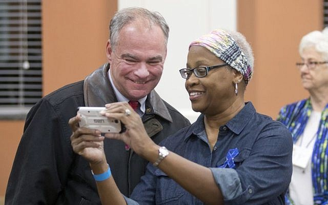 Democratic vice presidential candidate US Sen. Tim Kaine, D-Va., takes a selfie with a poll worker as he prepares to vote in Richmond, Va., Tuesday, Nov. 8, 2016 (AP Photo/Steve Helber)