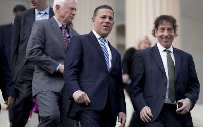 Then Rep.-elect Jamie Raskin, D-Md., right, Rep.-elect Anthony Brown, D-Md., second from right, and others, arrive for a newly-elected House members freshman class photo on the Capitol steps, Tuesday, Nov. 15, 2016, in Washington. (AP Photo/Andrew Harnik)