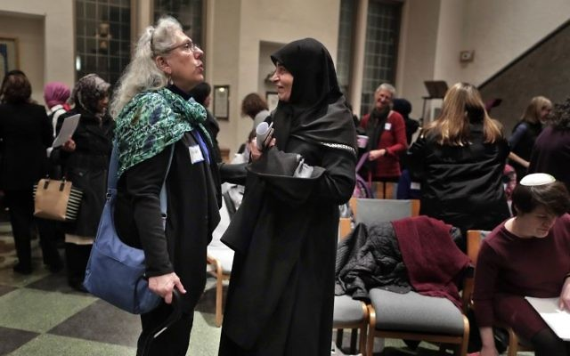 In this Thursday, Feb. 16, 2017 photo, members of the Sisterhood Salaam Shalom talk after a unity vigil held at the Jewish Theological Seminary in New York. (AP/Julie Jacobson)