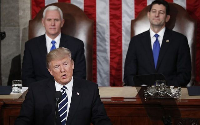 Vice President Mike Pence and House Speaker Paul Ryan of Wis. listen as President Donald Trump addresses a joint session of Congress on Capitol Hill in Washington, Tuesday, Feb. 28, 2017. (AP Photo/Pablo Martinez Monsivais)