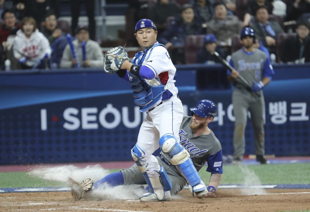 a1604f05b Israel s Zach Borenstein is forced out at home as South Korea s catcher  Yang Eui-ji