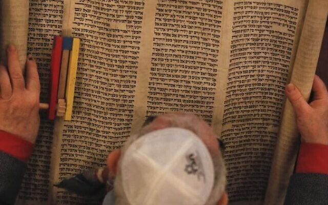 Illustrative: In this March 11, 2017 picture, a man reads The Book of Esther. (AP Photo/Vadim Ghirda)