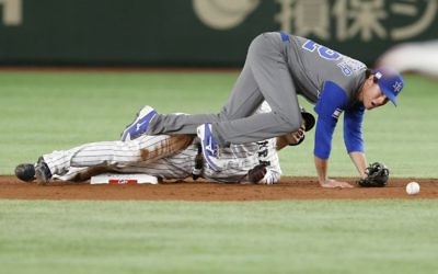 Japan's Seiya Suzuki steals second as Israel's second baseman Tyler Krieger drops the ball during the second inning of their second-round game at the World Baseball Classic in Tokyo, March 15, 2017. (AP/Toru Takahashi)
