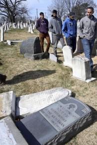 In this Monday, Feb. 27, 2017 file photo, volunteers from the Ahmadiyya Muslim Community survey damaged headstones at Mount Carmel Cemetery in Philadelphia. (AP/Jacqueline Larma)