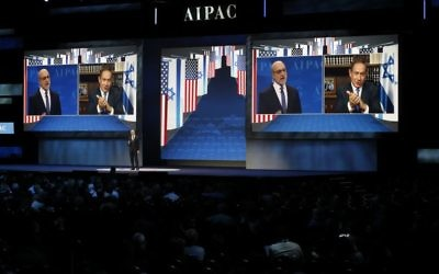 Prime Minister Benjamin Netanyahu is projected on screen in Washington, Monday, March 27, 2017, as he speaks to attendees of the AIPAC Policy Conference 2017 via satellite from Israel (AP Photo/Manuel Balce Ceneta)