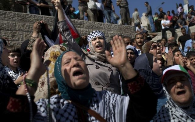 Palestinian women shout slogans at Damascus Gate, outside Jerusalem's old city, Friday, Sept. 27, 2013 marking the 13th anniversary of the second Palestinian uprising against Israeli occupation. (AP Photo/Bernat Armangue)
