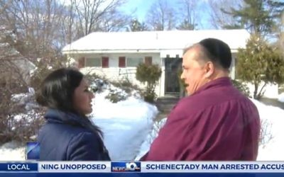 Andrew King, accused of reporting a false crime, shows News10 a swastika daubed outside his home in Schenectady, New York, February 10. 2017 (Screen capture: News10.com)