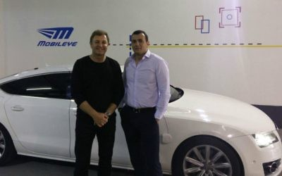 Mobileye's CEO Ziv Aviram, left, and Shai Babad, director general of Israel's Finance Ministry (Courtesy)