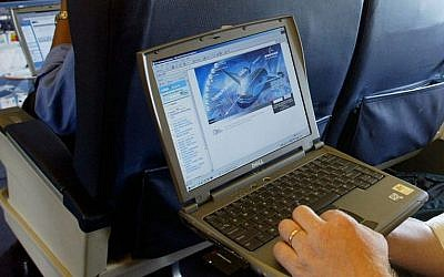 Illustrative photo of a laptop is used on a plane. (Chris Ison/PA, File via AP)