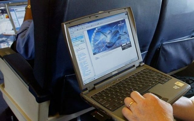 Illustrative photo of a laptop being used on a plane. (Chris Ison/PA, File via AP)