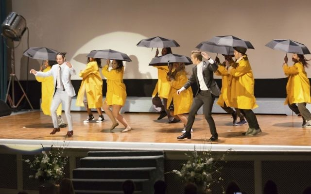 """Anthony """"Kanec"""" Carr, front left, and a troupe from Debbie Reynolds' dance studio perform an homage to """"Singin' in the Rain,"""" at the Carrie Fisher and Debbie Reynolds Memorial Service at The Forest Lawn on Saturday, March 25, 2017, in Los Angeles. (Willy Sanjuan/Invision/AP)"""