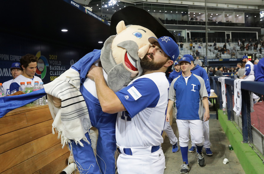 Infielder Cody Decker #14 of Israel holds team mascot 'The Mensch on a Bench' after the World Baseball Classic Pool A Game Five between the Netherlands and Israel at Gocheok Sky Dome on March 9, 2017 in Seoul, South Korea. (Chung Sung-Jun/Getty Images via JTA)