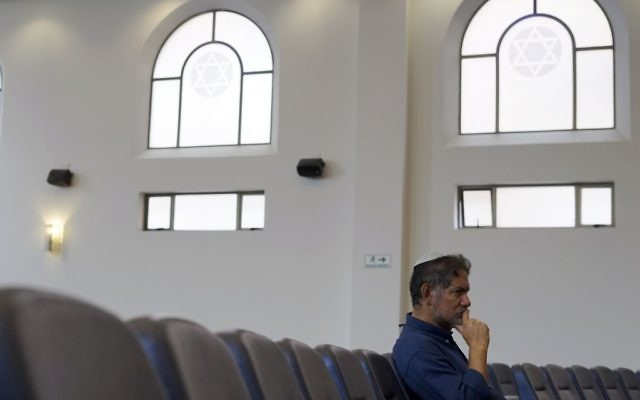 In this March 19, 2017 photo, Franklin Perez, listens to a rabbi at a synagogue in Bogota, Colombia. (AP Photo/Christine Armario)